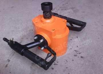 Hand-held pneumatic rock drill